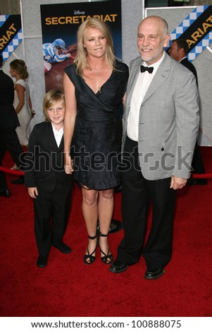 "Peta Wilson and son with John Malkovich  at the ""Secretariat"" Los Angeles Premiere, El Capitan, Hollywood, CA. 09-30-10"