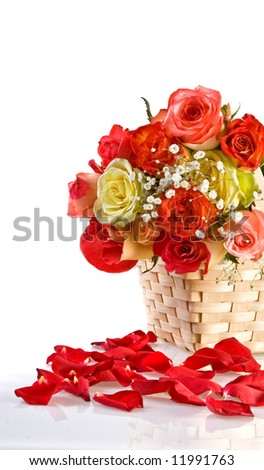 Petals and multicolored roses in a basket - stock photo