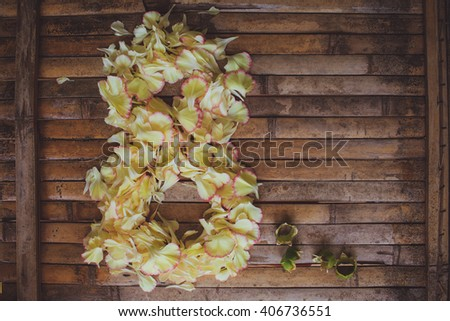 petals flowers form March  8  frame Women's Day postcard on brown wood board  background in rustic style
