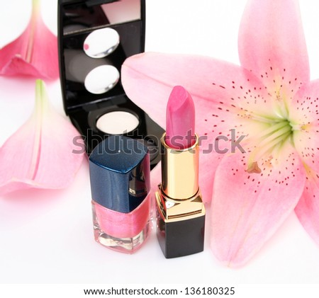 Petals of a pink lily and lipstick