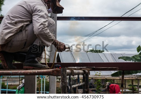 Petchabun,Thailand-July 8,2016:Man is working building a home and measuring some post.
