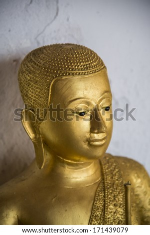 PETCHABURI, THAILAND - DECEMBER 10 One of golden Buddhist saint statue on December 10, 2013 in Petchaburi, Thailand. Buddhist person usually make and give statue to temple for pray.