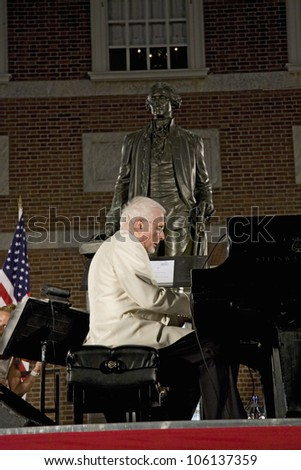 Peter Nero and the Philly Pops performing in front of historic Independence Hall, Philadelphia, Pennsylvania on July 3, 2009 - stock photo