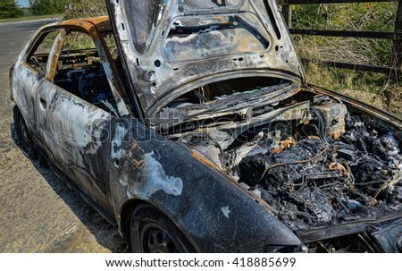 Peterborough Cambridgeshire UK Wandsford on the A47 road 5th May2016  Abandoned car torched set on fire and burnt out
