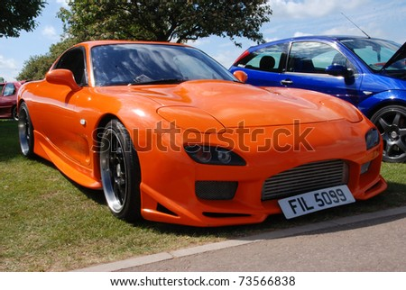 PETERBOROUGH, ENGLAND   MAY 23: Orange Mazda RX7 On May 23, 2009 In