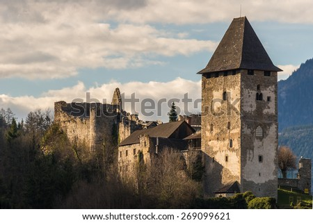Petersberg Castle in medieval Friesach, the oldest town of Carinthia in Austria, at sunset - stock photo