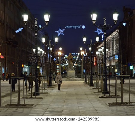 PETERSBURG, RUS-JANUARY 5, 2015:Malaya konyushennaya street in evening illumination. It is pedestrian street with lanterns and statue of writer Nikolai Gogol.  Unidentified people walking along street