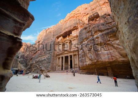 PETRA, JORDAN - OCT 12, 2014: The treasury or Al Khazna, it is the most magnificant and famous facade in Petra Jordan, it is 40 meters high, 2014 in Jordan - stock photo