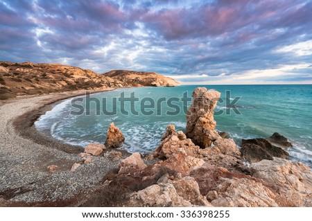 Petra tou Romiou, the birthplace of Aphrodite. Winter evening. Paphos. Cyprus. - stock photo