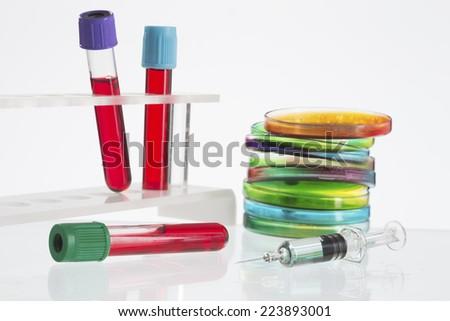 Petri dish, blood test, test-tube, syringe - stock photo