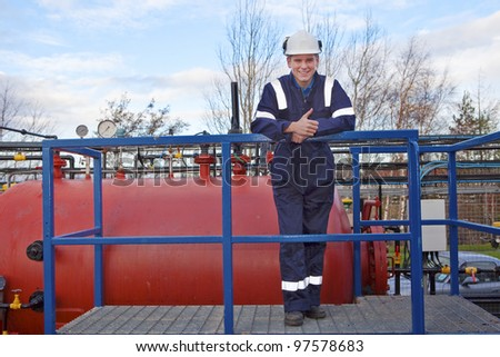 Petrochemical contractor posing in front of an oil refinery. Outdoor - stock photo