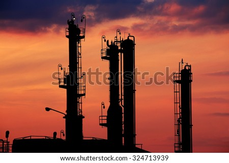 petrochemical factory silhouette twilight - stock photo