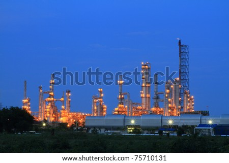 petrochemical industry on blue sky. - stock photo