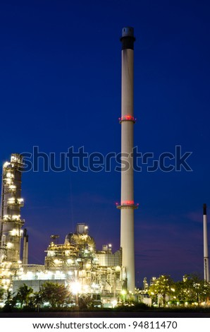 Petrochemical industry on sunset dark blue sky. - stock photo