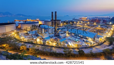 petrochemical industry on sunset , hong kong coal power station and oil tank