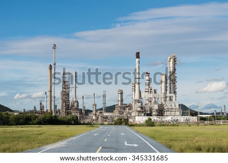 Petrochemical industry power with asphalt road - stock photo