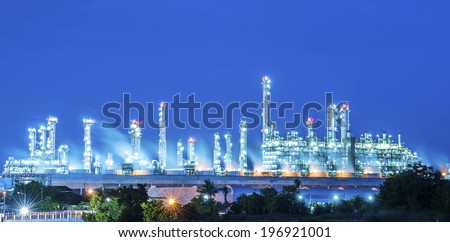 Petrochemical Oil and gas refinery at night sky - stock photo