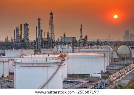 Petrochemical oil and gas refinery plant in sunset  - stock photo