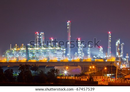 petrochemical oil refinery plant at night - stock photo