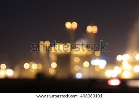 Petrochemical plant at night chemistry Blurred out of focus Bokeh - stock photo