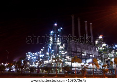 petrochemical plant  at night time - stock photo