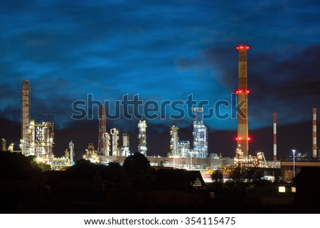 Petrochemical plant at night time with the reflection on the water.