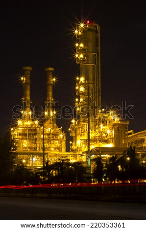 Petrochemical plant at twilight and light - stock photo