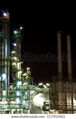 petrochemical plant in night time - stock photo