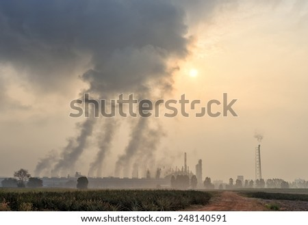 Petrochemical  plant located nearby pineapple field , during morning - stock photo