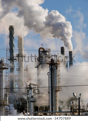 Petrochemical plant located venting steam and smoke, near Carlsbad, New Mexico - stock photo