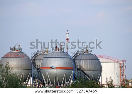 petrochemical plant oil tanks - stock photo