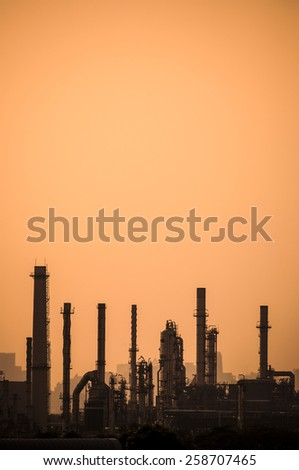 Petrochemical plant silhouette background - stock photo