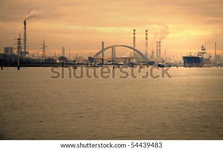 Petrochemical plants near a lagoon. Dramatic tone. - stock photo