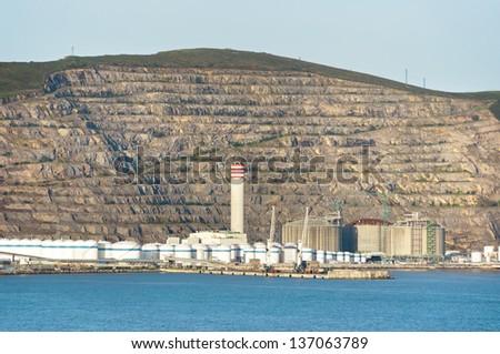 Petrochemical refinery near sea - stock photo