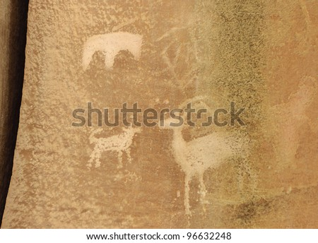 Petroglyph or rock art carvings of Native Americans on a canyon wall in Freemont,  National Park Capitol Reef  Utah, USA - stock photo