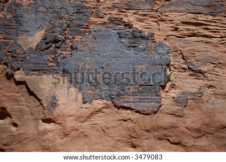 Petroglyph (rock carving) - stock photo