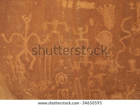 Petroglyphs carved into cliff wall by prehistoric Native Americans. Chaco Canyon National Park, New Mexico, USA. - stock photo