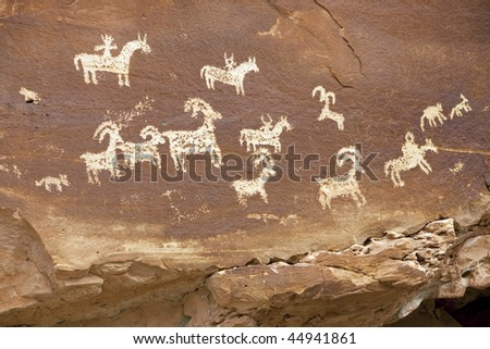 Petroglyps located at the trail head of Delicate Arch, Arches National Park. - stock photo