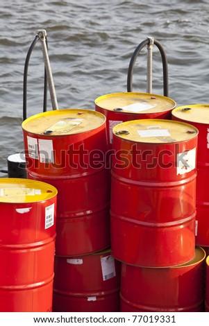 Petrol Barrel on the water - stock photo