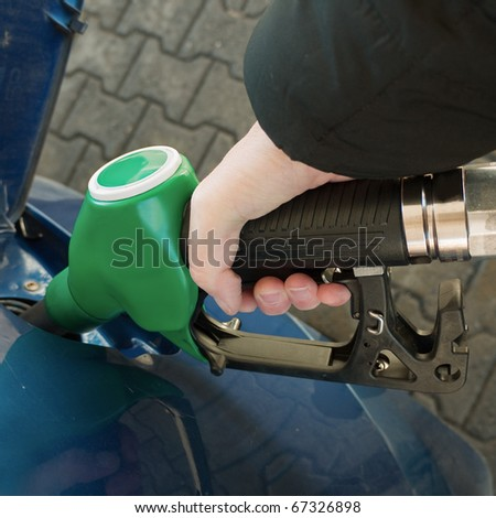 Petrol / gas - filling the car - stock photo