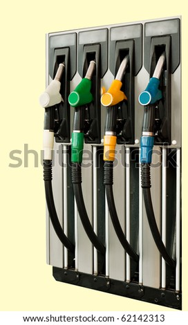 Petrol/gas station detail. Four nozzles. isolated on pale background.