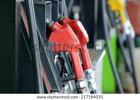 Petrol gas station pump and pumping gasoline fuel - stock photo