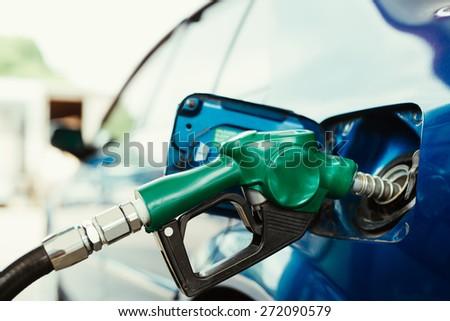 Petrol pump filling closeup - stock photo