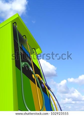 petrol pump over blue sky background - stock photo