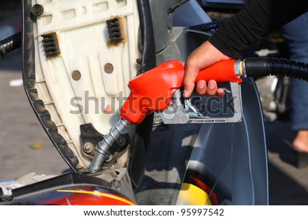 Petrol - refill fuel to motorcycle.