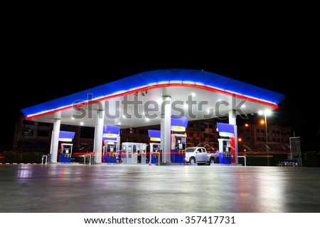 petrol station at night & copy space on top - stock photo