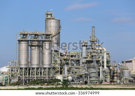 Petroleum and Refinery plant in winter season with blue sky , Eastern industrial of Thailand - stock photo