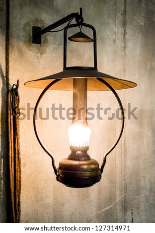 petroleum lamp  at a stable - stock photo