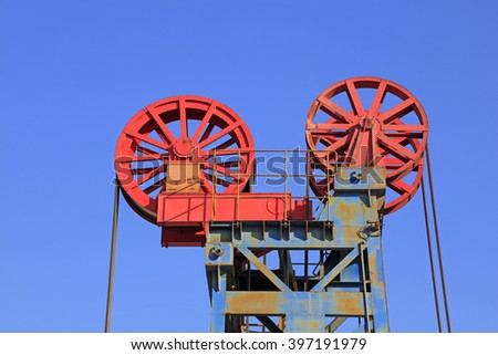 Petroleum machinery parts under blue sky in oilfield