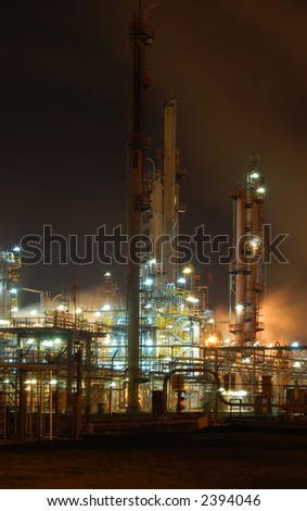 Petroleum refinery by night - stock photo